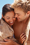 Cute young couple in love wrapped themselves in a towel