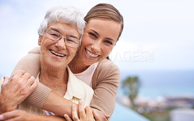 Buy stock photo Portrait of an affectionate mother and daughter standing outdoors