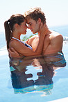 Cute couple in a swimming pool