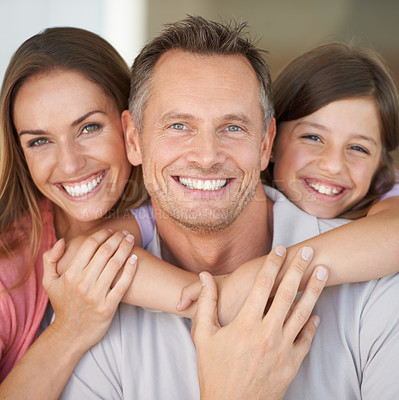 Buy stock photo A young girl with her parents spending time indoors