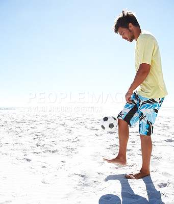 Buy stock photo Portrait of a handsome young football player at the beach