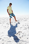 Full length image of a beach soccer player