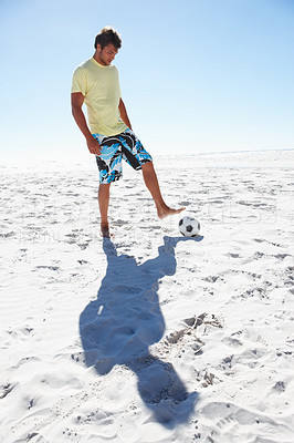 Buy stock photo Full length of a young beach soccer player