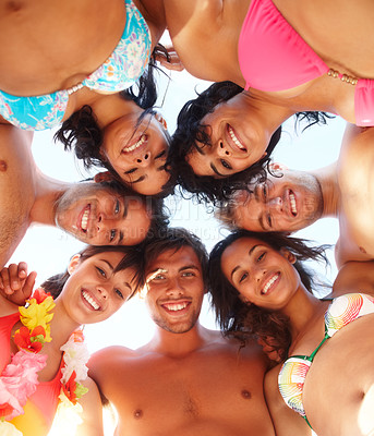 Buy stock photo Upward view: Teenage friends in a huddle at the beach