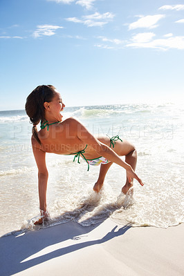 Buy stock photo Sexy young female enjoying at the sea shore