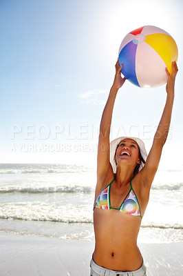 Buy stock photo Portrait of a hot girl in a bikini playing with a ball
