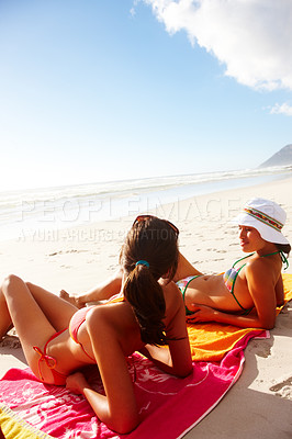 Buy stock photo Two sexy hot girls resting on the beach