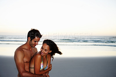 Buy stock photo Portrait of a happy young couple enjoying their vacation by the beach