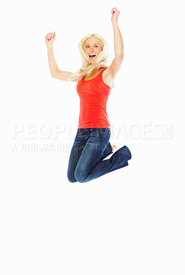 Buy stock photo Excited young woman jumping in the air, isolated on white