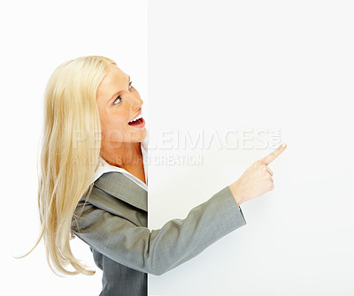 Buy stock photo Portrait of a happy business woman holding an empty billboard