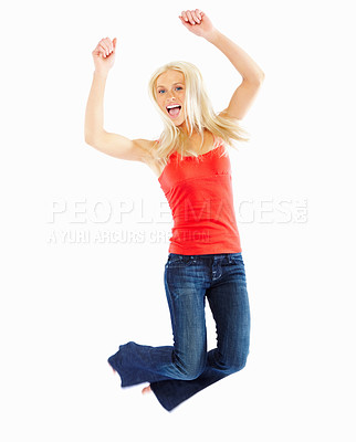 Buy stock photo Cheerful young female jumping of joy over white background