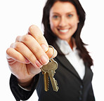 Happy business woman holding keys on white background