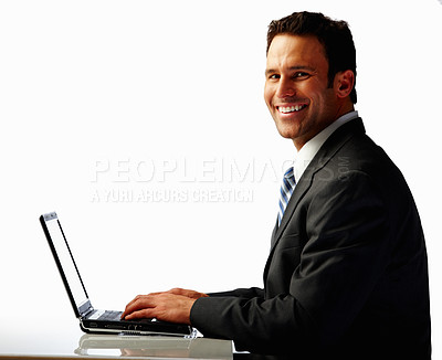 Buy stock photo Happy young business man working on a laptop over white