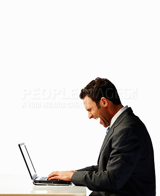 Buy stock photo Excited young business man working on a laptop