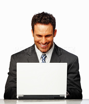 Buy stock photo A Happy successful business man smiling while working on laptop