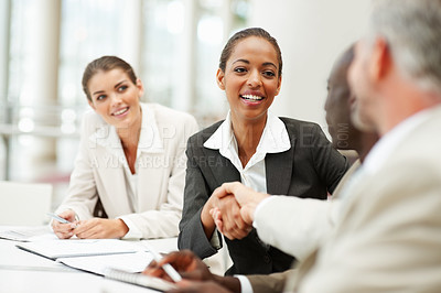 Buy stock photo Pretty young woman been congratulated for her work