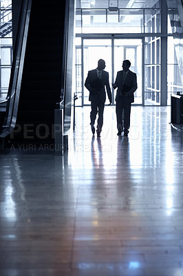 Buy stock photo Silhouette image of two business men walking together