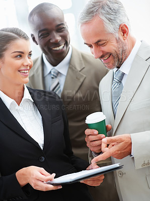 Buy stock photo A beautiful secretary discussing work with her senior boss with a colleague standing behind