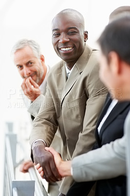 Buy stock photo Portrait of an African American business man shaking hands after a deal