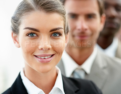 Buy stock photo Closeup portrait of a happy young business woman with her colleagues at her back
