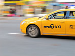 Taxi in New York - lens and motion blurred