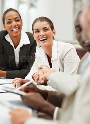 Buy stock photo Cute business woman shaking hands with her boss