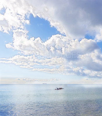 Buy stock photo An early morning photo of young people kayaking on the ocean