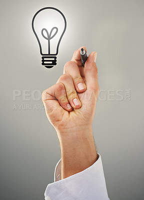 Buy stock photo Cropped shot of a man holding a marker wit the image of a lightbulb above his hand