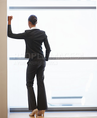 Buy stock photo Rear view full length image of a successful young business woman