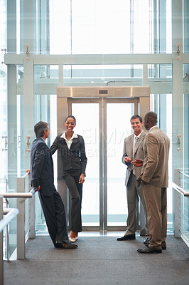Buy stock photo Portrait of group of business colleagues at the building entrance