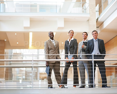 Buy stock photo Portrait of business colleagues standing by a railing