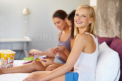 Buy stock photo Shot of a group of female friends spending quality time together at home