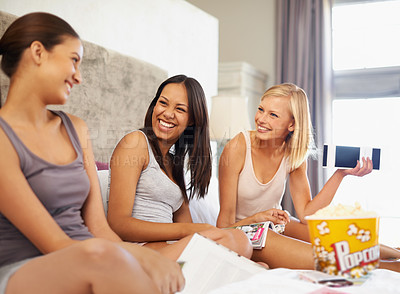 Buy stock photo Shot of a group of young friends spending quality time together at home