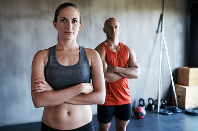 Buy stock photo Cropped shot of a young man and woman in gymwear