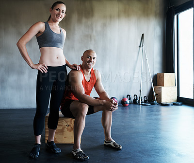 Buy stock photo Portrait of a young couple training together at the gym