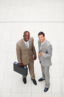 Buy stock photo Top view of two happy business men standing together