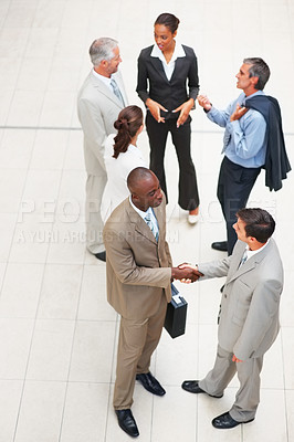 Buy stock photo Portrait of successful positive business people busy communicating with eachother