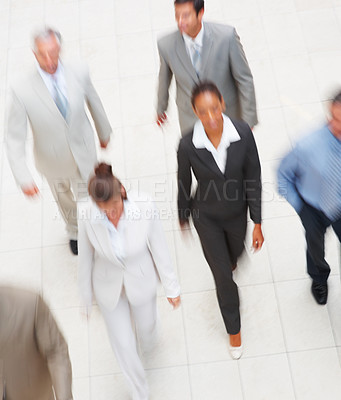 Buy stock photo Blurred image of a group of business colleagues, walking