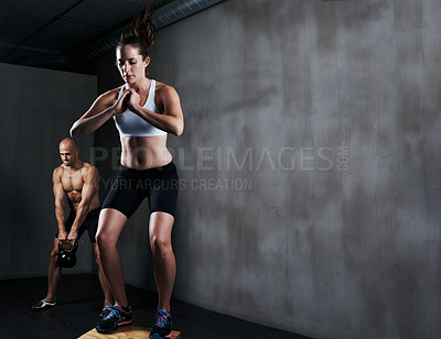 Buy stock photo A workout session in a gym
