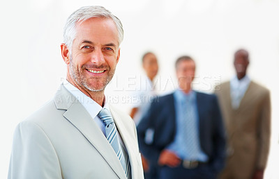 Buy stock photo Portrait of a happy mature business man with colleagues at the back