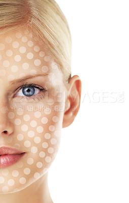 Buy stock photo Conceptual studio portrait of a young woman with a dot matrix overlay on her face