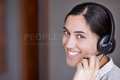 Buy stock photo Shot of an attractive young call centre operator