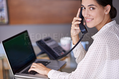 Buy stock photo A young businesswoman speaking on the landline