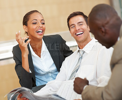 Buy stock photo Team of business colleagues sitting and enjoying themselves
