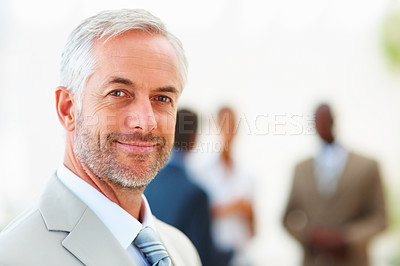 Buy stock photo Portrait of a college professor with people at the background