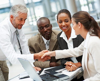 Buy stock photo Group of business people working together at a meeting