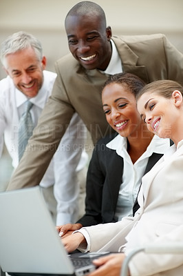 Buy stock photo Team of business people working together on a laptop