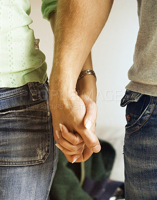 Buy stock photo Man and woman holding hands.