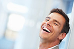 Happy handsome business man, laughing