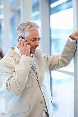 Buy stock photo Portrait of a mature business man speaking on the cellphone
